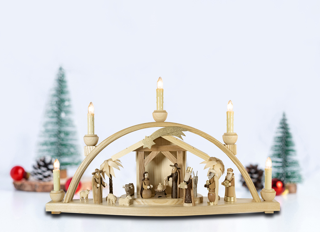 Candle arch (Schwibbogen) with Christmas crib - illuminated by electric lights